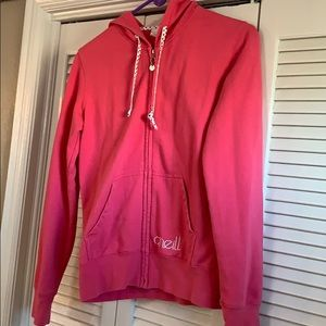Pink zip up sweatshirt.